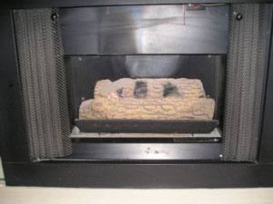 fake log ventless fireplace conversion to modern fireglass fireplace